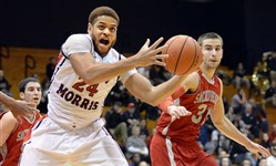 Robert Morris' Aaron Tate grabs a rebound last year against Sacred Heart.