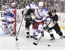 Penguins Nick Spaling and Marcel Goc battle for loose puck with Rangers captain Ryan McDonagh in the second period Sunday at Consol Energy Center.