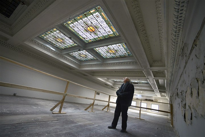 20150116bwPlayhouseBus02-1 Elmer B. Burger II, Point Park's architect and planner, looks around the upper floor of the Stock Exchange Building on Fourth Avenue, Downtown.