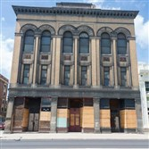 The owner of New York's Casellula Cheese & Wine Cafe is considering opening a restaurant in the former Masonic Hall in conjunction with nonprofit City of Asylum in Central North Side.
