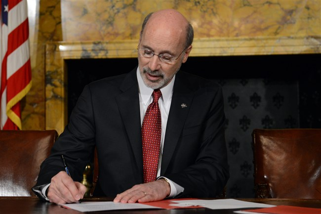 Gov. Tom Wolf signs two executive orders at the Pennsylvania Capitol in Harrisburg.