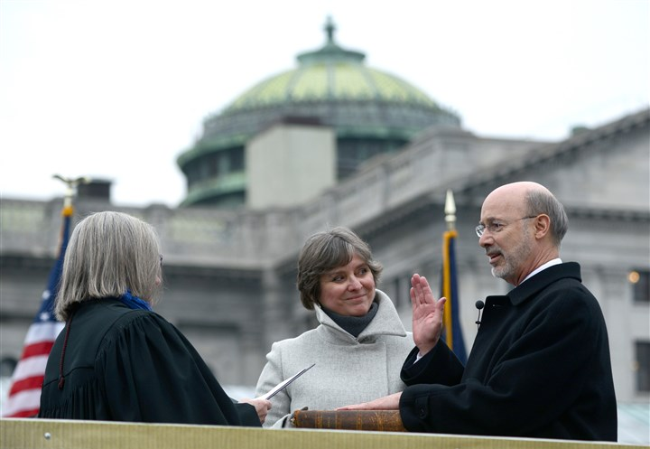 20150120MWHwolfLocal11-10 Gov. Tom Wolf, standing with his wife, Frances, is sworn into office by Judge Penny Blackwell at the Pennsylvania Capitol in Harrisburg.