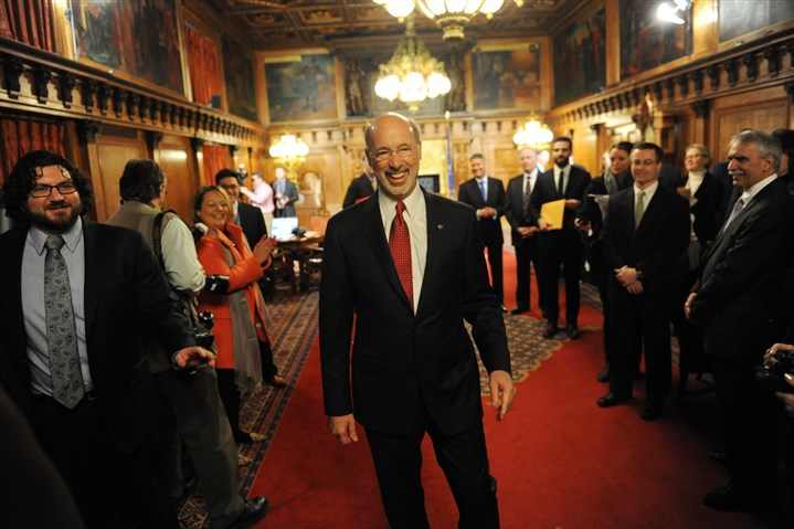 20150120MWHwolfLocal07-6 Gov. Tom Wolf greets supporters and cabinet members after being sworn into office inside the Governor's Reception Room at the Capitol in Harrisburg a year ago.