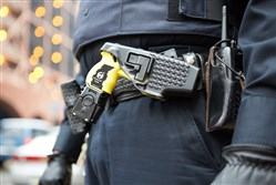 A standard issue police Taser worn by a Point Park University police officer.