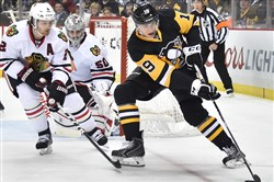 Penguins forward Beau Bennett gathers a loose puck against the Blackhawks during a January game at Consol Energy Center.