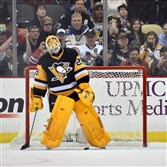 Penguins goalie Marc-Andre Fleury reacts after Blackhawks Patrick Kane scores during the shootout  at the Consol Energy Center.