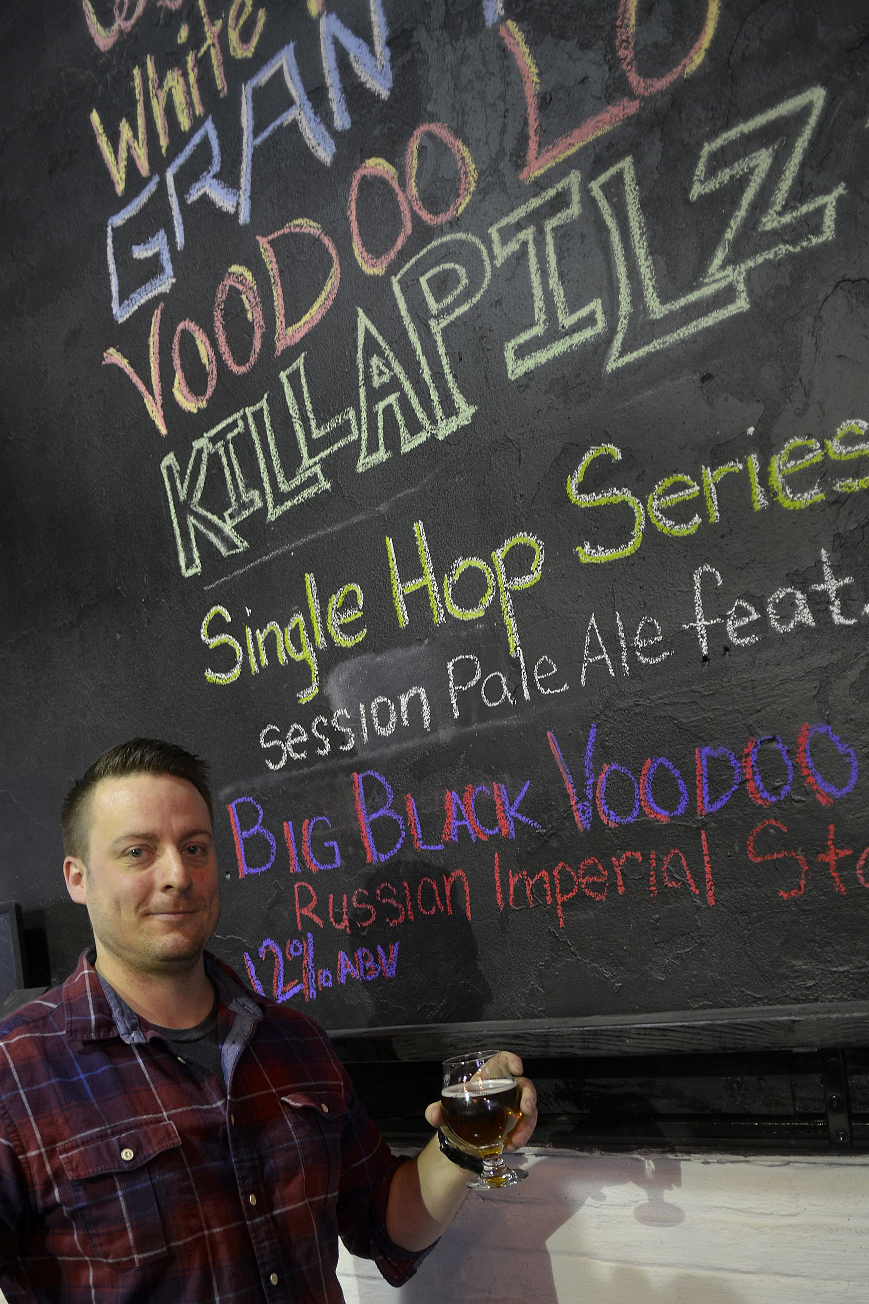 20150122lrvoodoofood15-14 Jake Voelker poses in the pub which is being prepped to open in the old Homestead municipal building by Meadville's Voodoo Brewery.