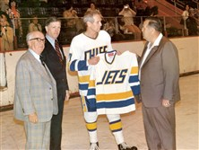 "In this 1976 file photo, Johnstown Jets President Ed Hoke, far right, presents actor Paul Newman with a Jets jersey as Jets General Manager John Mitchell, far left, and North American Hockey League Commissioner Bill Beagen look on during a break in filming the movie ""Slap Shot."""