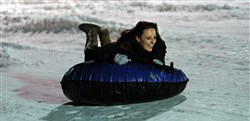 Jessica Mancuso, from the North Hills, rides the tube at Boyce Park.