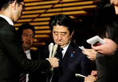 Japanese Prime Minister Shinzo Abe speaks to reporters after a Cabinet meeting early today at his official residence in Tokyo.