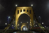 Snow begins to accumulate on the Roberto Clemete Bridge on Fort Duquesne Blvd, Sunday evening.