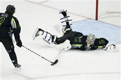 Chicago's Duncan Keith scores against Penguins goalie Marc-Andre Fleury in the NHL All-Star Game Sunday night in Columbus, Ohio.