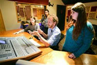 Jesse Naus, center, explains how he uses the soundboards to Point Park University students at Red Caiman Studios, Uptown. From left, Tyler McLaughlin, graduate assistant Rachel Vigliotti and Alexis Galasso are involved at Pioneer Records, a university record label.