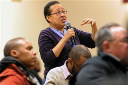 C. Denise Johnson, center, asks questions of Clayco Realty Group developers during Monday's meeting.