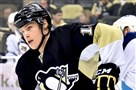 Beau Bennett skates up ice against the Jets in the first period at the Consol Energy Center.
