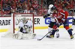 Washington Capitals left wing Alex Ovechkin (8) scores a goal on Penguins goalie Marc-Andre Fleury in the first period at Verizon Center.