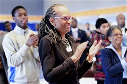 "Pittsburgh Public Schools Superintendent Linda Lane applauds senior scholars at the ""We Promise Scholars"" gathering at Duquesne University in January."