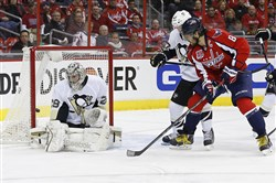 Capitals left wing Alex Ovechkin scores on Penguins goalie Marc-Andre Fleury in the first period Jan 28 at the Verizon Center in Washington, D.C.