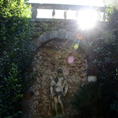 A small grotto in formal garden in a courtyard at Villa Cicogna Mozzoni in Bisuschio, Italy.