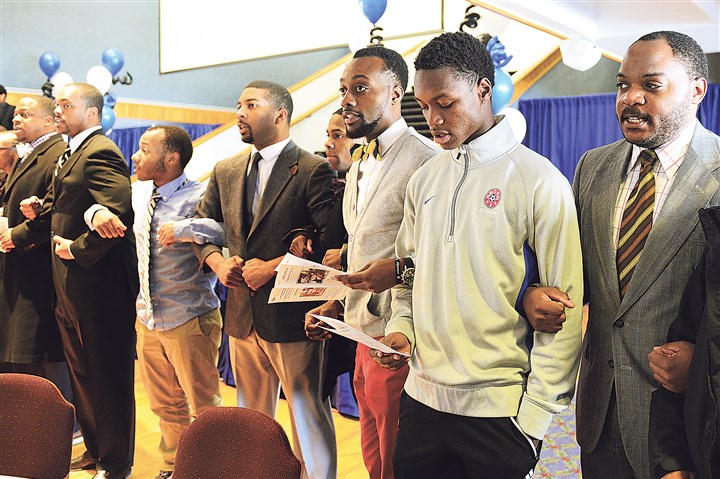 20150128radWePromiseLocal02-17 Mentors and students link arms as they recite their Manhood Statement at the beginning of the We Promise Scholars gathering Wednesday at Duquesne University.