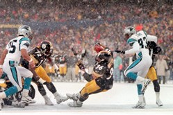 From the archives: Jerome Bettis leans across the goal line for a touchdown in the fourth quarter of a December 26, 1999 game against Carolina at Three Rivers Stadium.