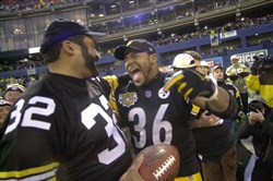 From the archives: Franco Harris and Jerome Bettis after the final Steelers game at Three Rivers Stadium, December 16, 2000.