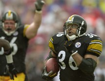 Newly-minted Pro Football Hall of Fame inductee Jerome Bettis takes off on a 46-yard touchdown run against Tampa Bay in October 2001 while guard Alan Faneca raises his arms in the background.