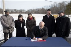 Gov. Tom Wolf signs an executive order restoring a moratorium on new drilling leases involving public lands, Thursday, January 29, 2015, at the Benjamin Rush State Park in Philadelphia.