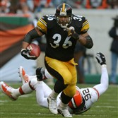 Recent Pro Football Hall of Fame inductee Jerome Bettis runs past Cleveland Browns Courtney Brown at Browns Stadium in Cleveland in November 2001.