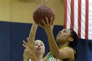 Blackhawk's Mariah Evans drives to the hoop against Hopewell's Abby Losco.