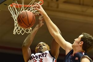 Robert Morris' Andre Fredrick is fouled by Fairleigh Dickinson's Scott Kingsley in the first half at the Sewall Center.