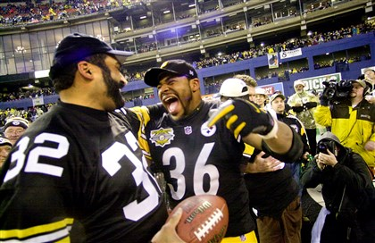 Franco Harris and Jerome Bettis with the ball used in the Immaculate Reception after the final Steelers game at Three Rivers Stadium.