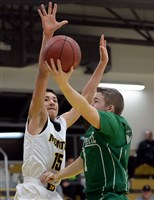 South Fayette's Jack Relihan drives to the basket against Montour's K.J. Rhodes Friday night.