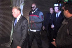 "This image from video shows Death Row Records founder Marion ""Suge"" Knight, right, walking into the Los Angeles County Sheriffs department early Friday morning in connection with a hit-and-run incident that left one man dead and another injured."