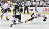 The Penguins' Sidney Crosby makes a move around Nashville's Roman Josi in the first period at the Consol Energy Center.