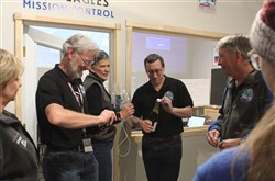 The Two Eagles Balloon mission control team gets ready to pop the cork on a bottle of champagne Saturday in Albuquerque, N.M., following the successful landing of the helium-filled balloon just off the coast of Baja in California.
