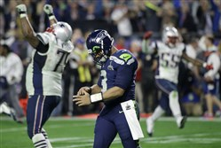 Seahawks quarterback Russell Wilson walks off the field after throwing an interception to Patriots strong safety Malcolm Butler in the fourth quarter of Super Bowl XLIX on Sunday.