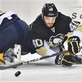 Maxim Lapierre dives for a loose puck during a game against Nashville earlier this month at the Consol Energy Center.