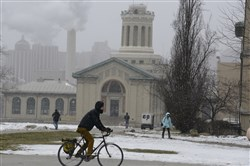 A cyclist rides in front of Hamerschlag Hall on the CMU campus in Oakland in early February.
