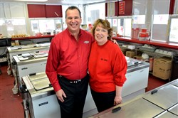 Bruster's CEO Jim Sahene and store owner Carolyn Cimato in Mrs. Cimato's Ross store on Lowries Run Road.
