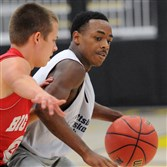 Stephon McGinnis (right), shown here in a summer basketball league game in July, is this week's male athlete of the week.