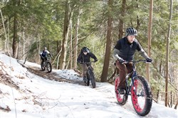 Cyclists ride their Fat Bikes along a trail in the Montour Woods Conservation Area in Moon.