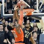 Pitt's Sheldon Jeter tries to block a dunk by Syracuse' Rakeem Christmas in the second half Saturday, February 7, 2015, at the Petersen Events Center.