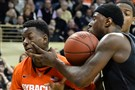 Pitt's Jamel Artis and Syracuse's Kaleb Joseph's battle during last season's game in Oakland.