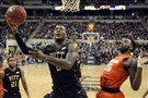 Pitt's Michael Young drives against Syracuse' Rakeem Christmas in the second half Saturday, February 7, 2015, at the Petersen Events Center.
