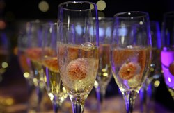Raspberries float in champagne at the Oscar party last year.