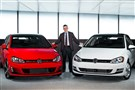 Michael Horn, CEO of Volkswagen Group of America, stands with the 2015 Golf and the Golf GTA, winner of the North American Car of the Year Award.