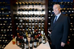 Kevin Joyce, owner of The Carlton in Downtown Pittsburgh, shows a selection of French and Italian wines.
