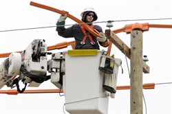 Dillon Walton, a second-year student in the Westmoreland Community College electric utility program, trains at West Penn Power's training facility in Hempfield.