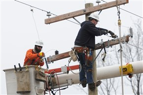 Mike Baranovich, left, and Clint Sarver train atop a utility pole at West Penn Power's training facility in Hempfield. West Penn Power serves 720,000 customers in southwestern Pennsylvania.